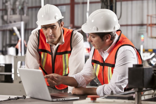 Workers at laptop computer